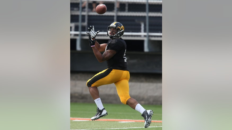 Iowa senior wide receiver Kevonte Martin-Manley pulls in a pass during their spring NCAA college football game Saturday, April 12, 2014, at Valley High Stadium in Wesst Des Moines, Iowa. (AP Photo/The Des Moines Register, Bryon Houlgrave)  MAGS OUT, TV OUT, NO SALES, MANDATORY CREDIT
