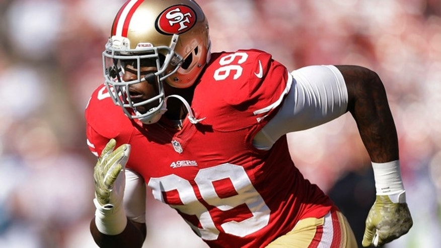 In this Nov. 10, 2013, file photo, San Francisco 49ers linebacker Aldon Smith warms up for the 49ers' NFL football game against the Carolina Panthers in San Francisco. Smith has been arrested at Los Angeles International Airport after authorities said he became belligerent during a security screening and threatened that he had a bomb.