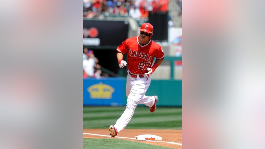 Los Angeles Angels' Mike Trout rounds third base after hitting a one-run home run off New York Mets starting pitcher Bartolo Colon during the first inning of a baseball game in Anaheim, Calif., Sunday, April 13, 2014. (AP Photo/Kelvin Kuo)