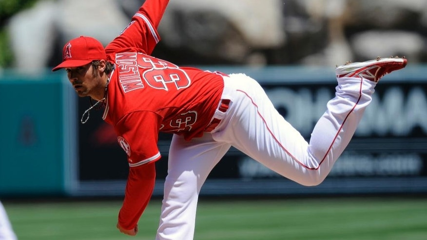 Los Angeles Angels starting pitcher C.J. Wilson delivers during the first inning of a baseball game against the New York Mets in Anaheim, Calif., Sunday, April 13, 2014. (AP Photo/Kelvin Kuo)