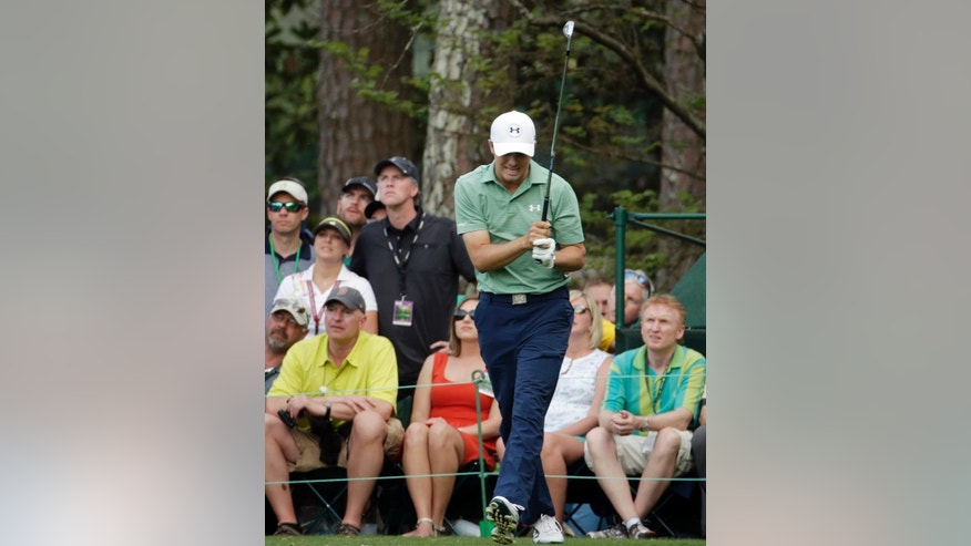Jordan Spieth reacts to his tee shot on the 16th hole during the fourth round of the Masters golf tournament Sunday, April 13, 2014, in Augusta, Ga. (AP Photo/Charlie Riedel)