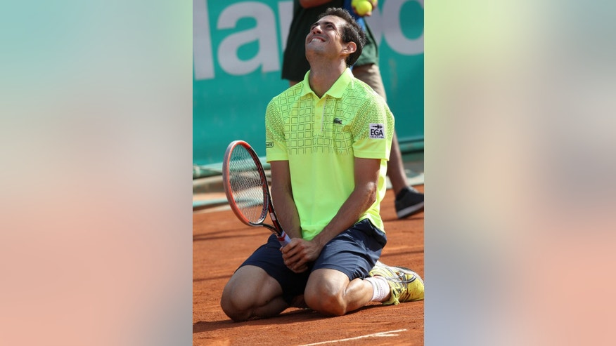 Guillermo Garcia-Lopez of Spain reacts after he won the men's final of the Hassan II Grand Prix tennis tournament, in Casablanca, Morocco, Sunday, April 13, 2014. Guillermo Garcia-Lopez won  5-7, 6-4. 6-3. (AP Photo/ Abdeljalil Bounhar)