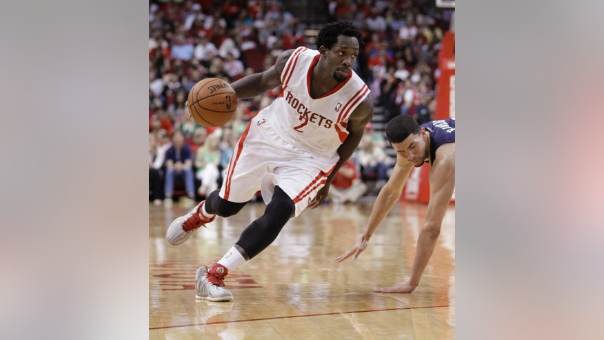 Houston Rockets guard Pat Beverley drives to the basket during the second quarter of an NBA basketball game against the New Orleans Pelicans, Saturday, April 12, 2014, in Houston. (AP Photo/Patric Schneider)