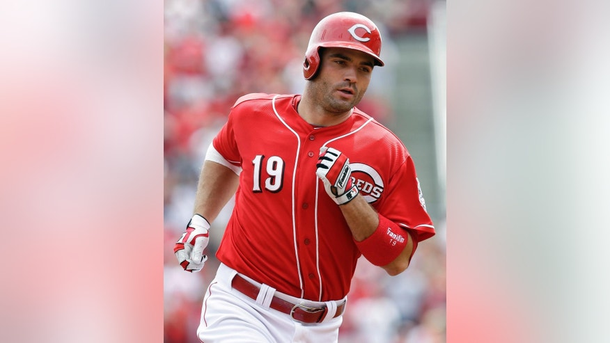 CORRECTS TO STARTING PITCHER - Cincinnati Reds' Joey Votto rounds the bases after hitting a two-run home run off Tampa Bay Rays starting pitcher Cesar Ramos in the third inning of a baseball game, Sunday, April 13, 2014, in Cincinnati. (AP Photo/Al Behrman)