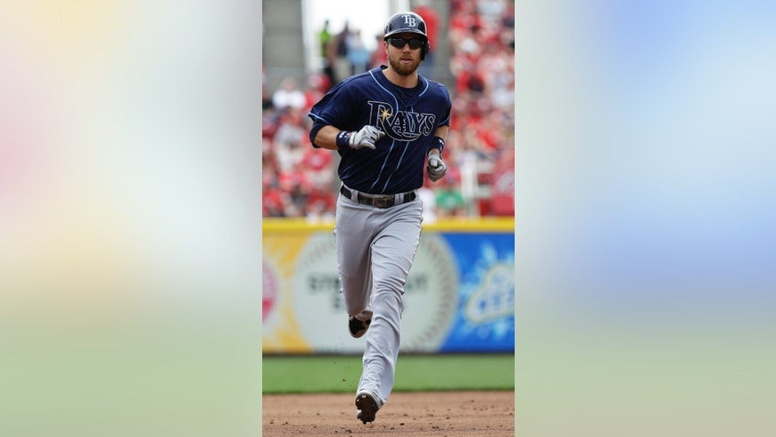 Tampa Bay Rays' Ben Zobrist rounds the bases after hitting a two-run home run off Cincinnati Reds starting pitcher Tony Cingrani in the third inning of a baseball game, Sunday, April 13, 2014, in Cincinnati. (AP Photo/Al Behrman)