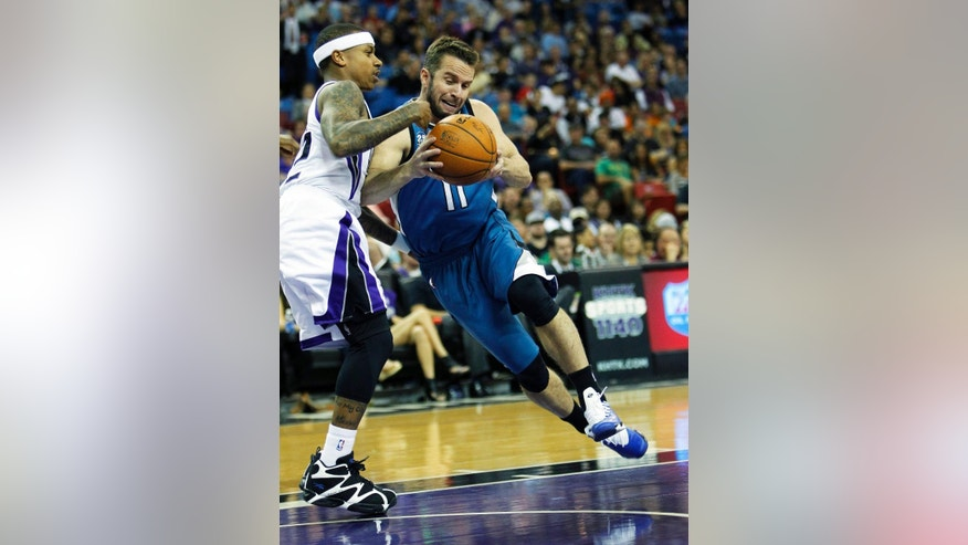 Minnesota Timberwolves guard Jose Barea (11) drives to the basket against Sacramento Kings defender Isaiah Thomas during the first half of an NBA basketball game in Sacramento, Calif., on Sunday, April 13, 2014.(AP Photo/Steve Yeater)