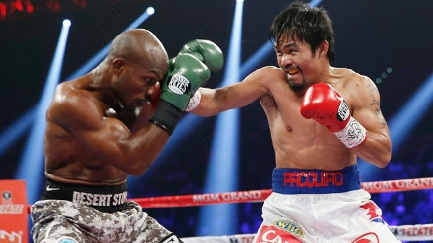April 12, 2014: Manny Pacquiao, right, of the Philippines, throws a right at the head of Timothy Bradley during their WBO welterweight title boxing fight in Las Vegas. (AP Photo/Eric Jamison)