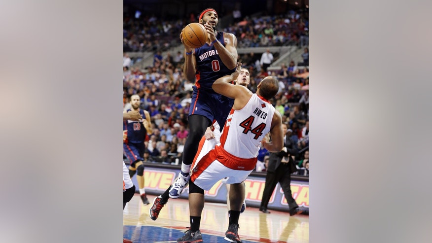 Detroit Pistons center Andre Drummond (0) shoots over the defense of Toronto Raptors forward Chuck Hayes (44) during the first half of an NBA basketball game in Auburn Hills, Mich., Sunday, April 13, 2014. (AP Photo/Carlos Osorio)