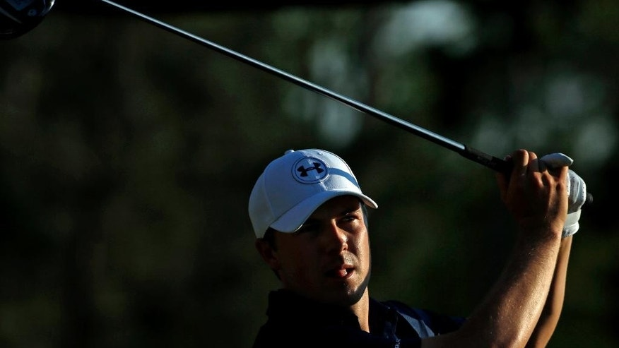 Jordan Spieth tees off during the third round of the Masters golf tournament Saturday, April 12, 2014, in Augusta, Ga. (AP Photo/David J. Phillip)