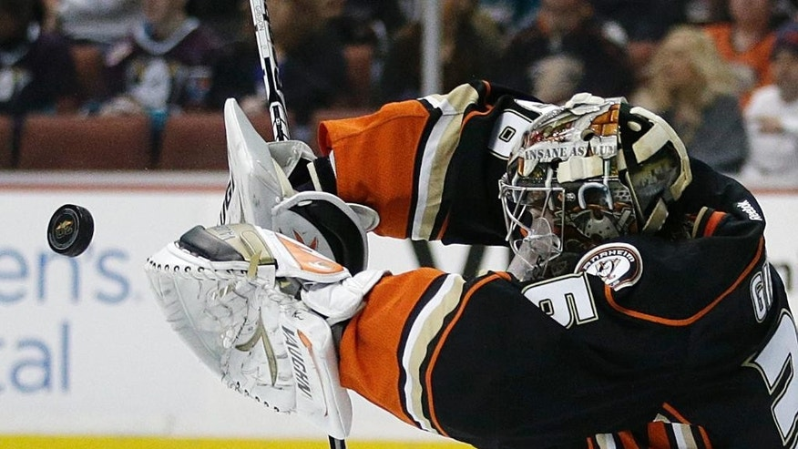 Anaheim Ducks goalie John Gibson deflects the puck during the first period of an NHL hockey game against the San Jose Sharks on Wednesday, April 9, 2014, in Anaheim, Calif. (AP Photo/Jae C. Hong)