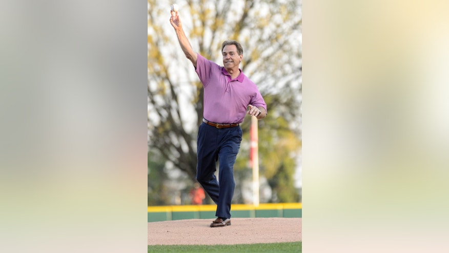 Alabama football coach Nick Saban throws out the ceremonial first pitch at an NCAA college baseball game between Alabama and Auburn, Friday, April 11, 2014, at Sewell-Thomas Stadium in Tuscaloosa, Ala. (AP Photo/Alabama Media Group, Vasha Hunt) MAGAZINES OUT