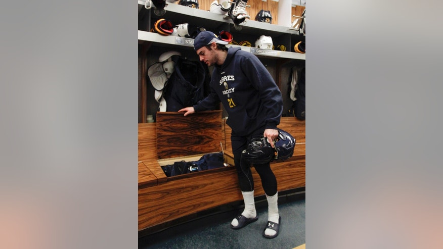 Buffalo Sabres right wing Drew Stafford cleans out his locker on Monday, April 14, 2014, after the NHL hockey team clinched the NHL's worst record, in Buffalo, N.Y. (AP Photo/Nick LoVerde)
