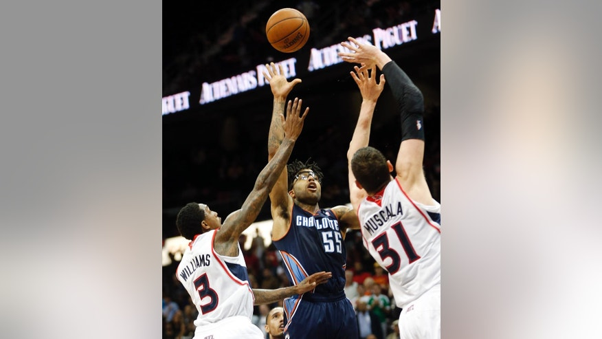 Charlotte Bobcats guard Chris Douglas-Roberts (55) hits the game-winning shot against Atlanta Hawks Louis Williams (3) and  Mike Muscala (31) as time expires in the second half of an NBA basketball game Monday, April 14, 2014 in Atlanta.  Charlotte won 95-93. (AP Photo/John Bazemore)