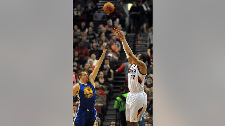 Portland Trail Blazers forward LaMarcus Aldridge (12) shoots the ball over Golden State Warriors forward David Lee (10) during the first half of an NBA basketball game in Portland, Ore., Sunday, April 13, 2014. (AP Photo/Steve Dykes)