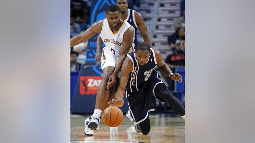 New Orleans Pelicans guard Anthony Morrow (3) and Oklahoma City Thunder forward Kevin Durant (35) chase after a loose ball in the first half of an NBA basketball game in New Orleans, Monday, April 14, 2014. (AP Photo/Gerald Herbert)