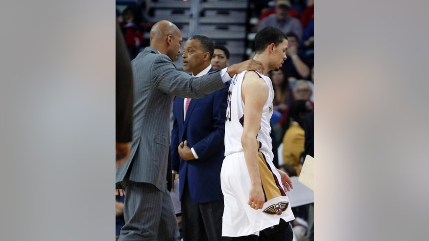 New Orleans Pelicans head coach Monty Williams walks guard Austin Rivers (25) off the court after he got into a scuffle with Oklahoma City Thunder forward Nick Collison in the first half of an NBA basketball game in New Orleans, Monday, April 14, 2014. Both Rivers and Collison were ejected from the game. (AP Photo/Gerald Herbert)
