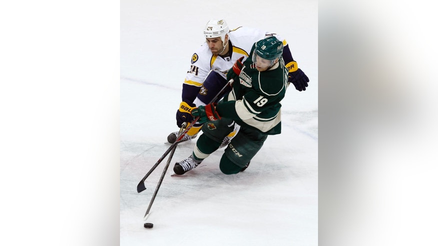 Minnesota Wild center Stephane Veilleux (19) and Nashville Predators left wing Eric Nystrom (24) chase the puck during the first period of an NHL hockey game in St. Paul, Minn., Sunday, April 13, 2014. (AP Photo/Ann Heisenfelt)
