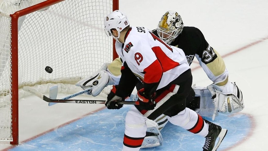 Ottawa Senators' Jason Spezza (19) backhands the game-winning shootout goal past Pittsburgh Penguins goalie Jeff Zatkoff (37) during the NHL hockey game in Pittsburgh, Sunday, April 13, 2014. The Senators won 3-2. (AP Photo/Gene J. Puskar)