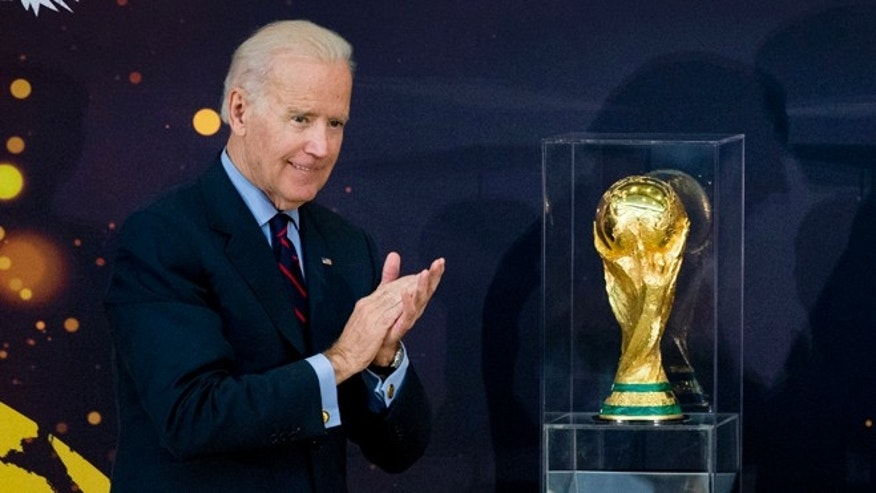 Vice President Joe Biden and Secretary of State John Kerry applaud after unveiling the FIFA World Cup trophy, the actual trophy that will be awarded to the winner of this years World Cup soccer tournament in Brazil, Monday, April 14, 2014, during a ceremony at the State Department in Washington. (AP Photo/Manuel Balce Ceneta)