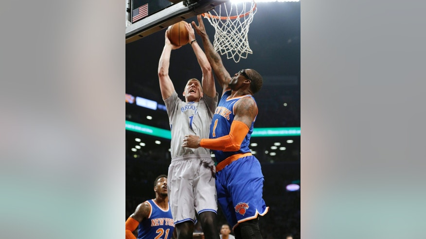 New York Knicks' Amare Stoudemire (1) blocks a shot by Brooklyn Nets' Mason Plumlee (1) during the first half of an NBA basketball game Tuesday, April 15, 2014, in New York. (AP Photo/Frank Franklin II)