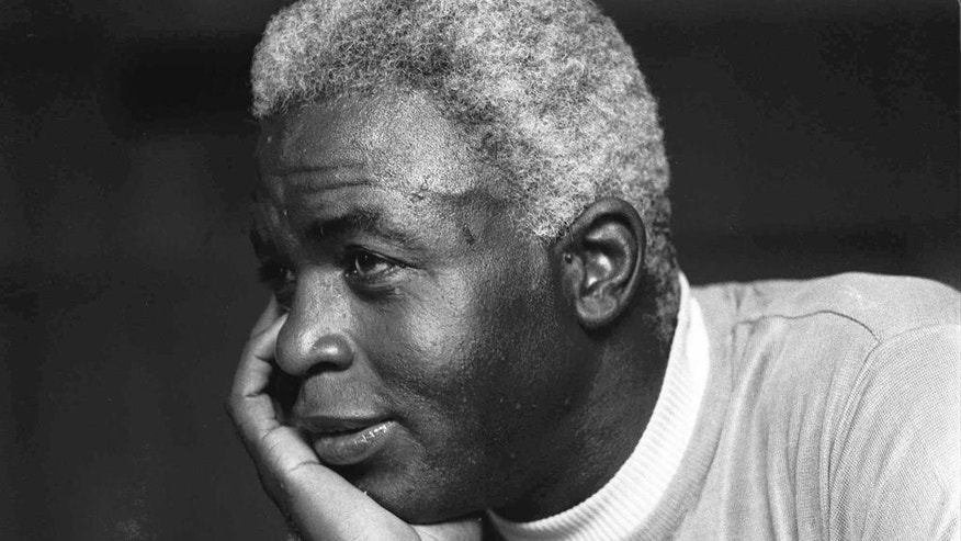 FILE - In this June 30, 1971, file photo, Jackie Robinson poses at his home in Stamford, Conn. Baseball holds tributes across the country on Jackie Robinson Day, Tuesday, April 15, 2014, the 67th anniversary marking the end of the game's racial barrier. (AP Photo/File)