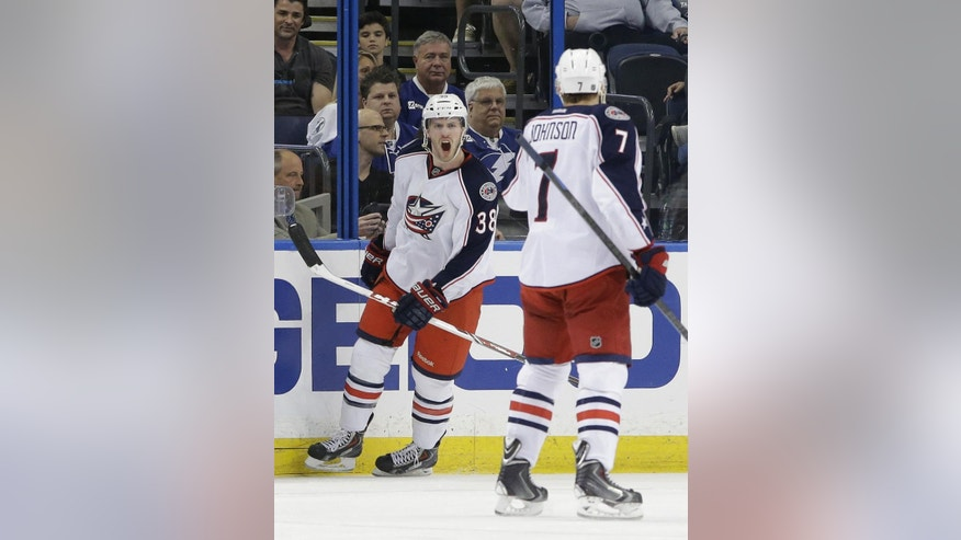 FILE - In this April 11, 2014 file photo, Columbus Blue Jackets center Boone Jenner (38) celebrates with defenseman Jack Johnson (7) after scoring against the Tampa Bay Lightning during an NHL hockey game  in Tampa, Fla. Few people outside of their dressing room think the Blue Jackets have even a remote chance of beating the Pittsburgh Penguins in the first round of the Stanley Cup playoffs. After years of being an NHL doormat, they're used to being overlooked. (AP Photo/Chris O'Meara, File)