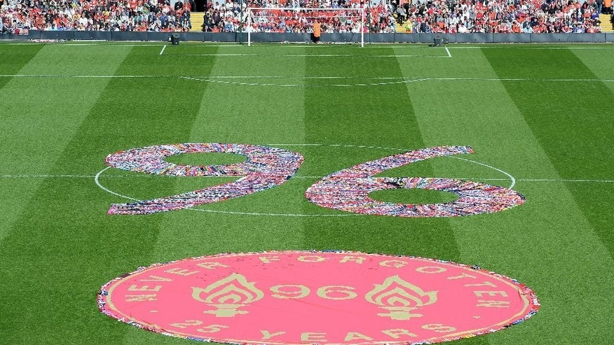 The figure 96, made up of fans scarves, fills the centre circle before the Hillsborough 25th Anniversary Memorial Service at Anfield Stadium, Liverpool, England, Tuesday April 15, 2014. About 30,000 people, including Liverpool players past and present, are expected to attend a memorial service at Anfield marking the 25th anniversary of the Hillsborough Stadium disaster that killed 96 Liverpool fans. Brendan Rodgers and Roberto Martinez, the managers of Liverpool and Everton, will deliver readings as Merseyside unites to remember those who died in Britain's worst sports tragedy. (AP Photo/PA, Martin Rickett)  UNITED KINGDOM OUT  NO SALES  NO ARCHIVE