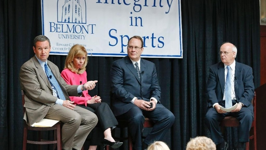 Panelists take part in a discussion on integrity in sports Tuesday, April 15, 2014, at Belmont University in Nashville, Tenn. From left are Mitch Barnhard, athletic director at Kentucky; Beth DeBauche, commissioner of the Ohio Valley Conference; Dan Beebe, former Ohio Valley Conference and Big 12 commissioner; and moderator Mike Strickland. (AP Photo/Mark Humphrey)