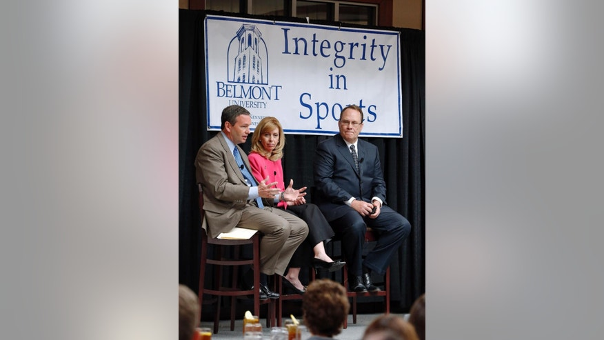 Panelists take part in a discussion on integrity in sports Tuesday, April 15, 2014, at Belmont University in Nashville, Tenn. From left are Mitch Barnhard, athletic director at Kentucky; Beth DeBauche, commissioner of the Ohio Valley Conference; and Dan Beebe, former Ohio Valley Conference and Big 12 commissioner. (AP Photo/Mark Humphrey)