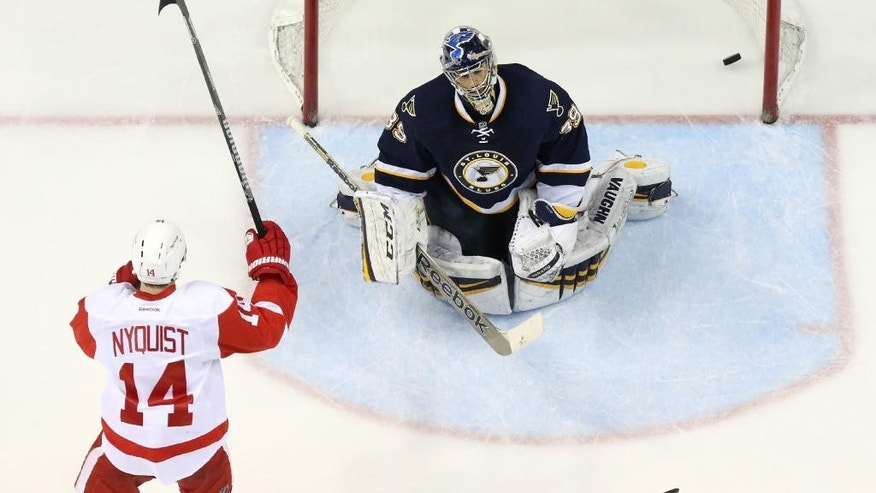 Detroit Red Wings right wing Gustav Nyquist, left, reacts after teammate Justin Abdelkader scored against St. Louis Blues goaltender Ryan Miller during the third period of an NHL hockey game Sunday, April 13, 2014, in St. Louis. Detroit won 3-0. (AP Photo/St. Louis Post-Dispatch, Chris Lee) EDWARDSVILLE OUT  ALTON OUT