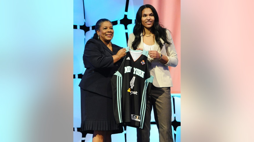 Maryland's Alyssa Thomas holds up New York Liberty jersey with WNBA president Laurel J. Richie after New York selected Thomas as the No. 4 pick in the WNBA basketball draft in, Monday, April 14, 2014, in Uncasville, Conn. Thomas was later traded to the Connecticut Sun along with Liberty's Kelsey Bone and the Liberty's 2015 first round pick for Connecticut's Tina Charles. (AP Photo/Jessica Hill)