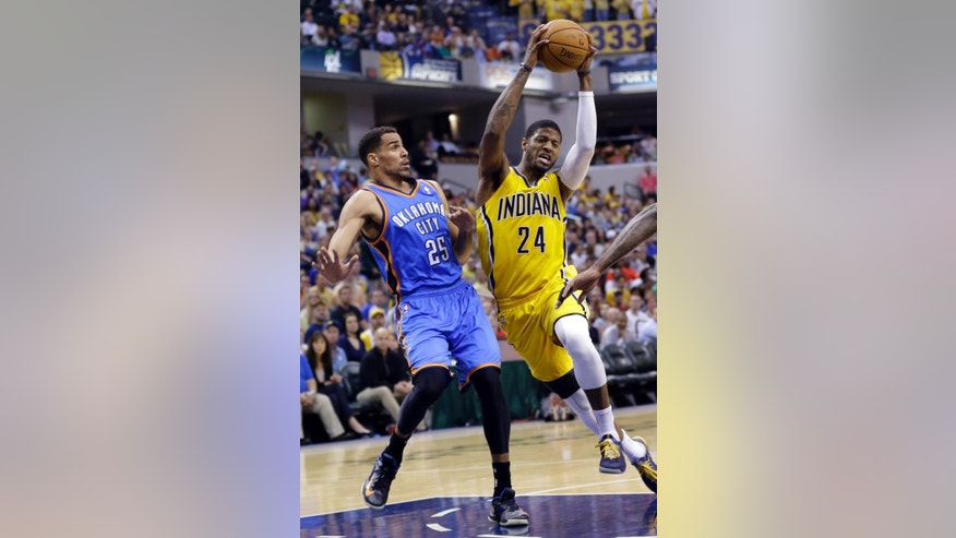 Indiana Pacers forward Paul George (24) cuts in front of Oklahoma City Thunder guard Thabo Sefolosha as he drives the lane in the second half of an NBA basketball game in Indianapolis, Sunday, April 13, 2014. The Pacers defeated the Thunder 102-97. (AP Photo/Michael Conroy)