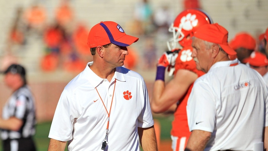 "April 12, 2014: Clemson coach Dabo Swinney walks the sideline during the NCAA college football team's spring game at Memorial Stadium in Clemson, S.C. University officials deny claims that Christianity is ""interwoven"" into Swinney's program. (AP/Anderson Independent-Mail, Mark Crammer)"