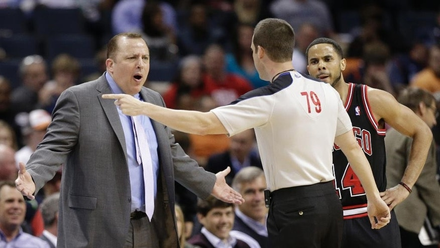 Chicago Bulls coach Tom Thibodeau, left, and player D.J. Augustin, right, argue a call with referee Kevin Scott, center, during the first half of an NBA basketball game against the Charlotte Bobcats in Charlotte, N.C., Wednesday, April 16, 2014. (AP Photo/Chuck Burton)