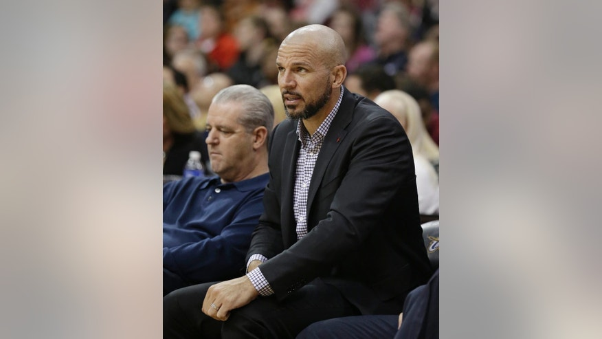 Brooklyn Nets head coach Jason Kidd , foreground, watches in the second half of an NBA basketball game against the Cleveland Cavaliers, Wednesday, April 16, 2014, in Cleveland. The Cavaliers defeated the Nets 114-85. (AP Photo/Tony Dejak)