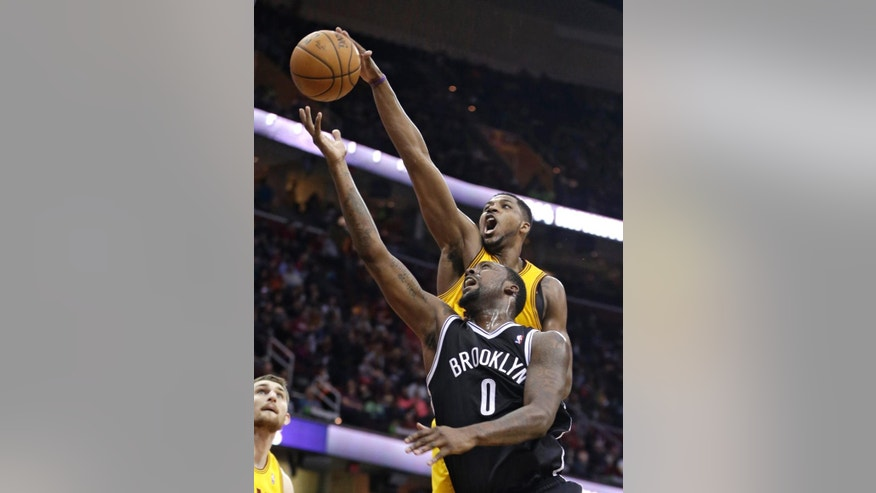 Cleveland Cavaliers' Tristan Thompson, back, blocks a shot by Brooklyn Nets' Andray Blatche (0) during the third quarter of an NBA basketball game on Wednesday, April 16, 2014, in Cleveland. The Cavaliers defeated the Nets 114-85. (AP Photo/Tony Dejak)