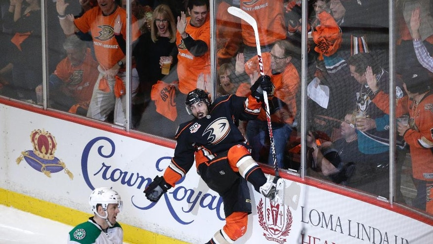 Anaheim Ducks' Mathieu Perreault, center, celebrates his goal near Dallas Stars' Vernon Fiddler during the first period in Game 1 of the first-round NHL hockey Stanley Cup playoff series on Wednesday, April 16, 2014, in Anaheim, Calif. (AP Photo/Jae C. Hong)
