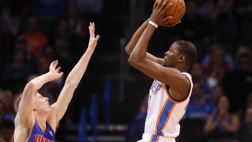 Oklahoma City Thunder forward Kevin Durant shoots over Detroit Pistons guard Kyle Singler during the first quarter of an NBA basketball game in Oklahoma City, Wednesday, April 16, 2014. (AP Photo/Sue Ogrocki)