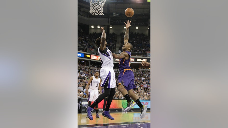 CORRECTS TO SUNS' P.J. TUCKER NOT ERIC BLEDSOE - Phoenix Suns' P.J. Tucker, right, shoots over Sacramento Kings  guard Ben McLemore during the first quarter of an NBA basketball game in Sacramento, Calif., Wednesday, April 16, 2014. (AP Photo/Rich Pedroncelli)