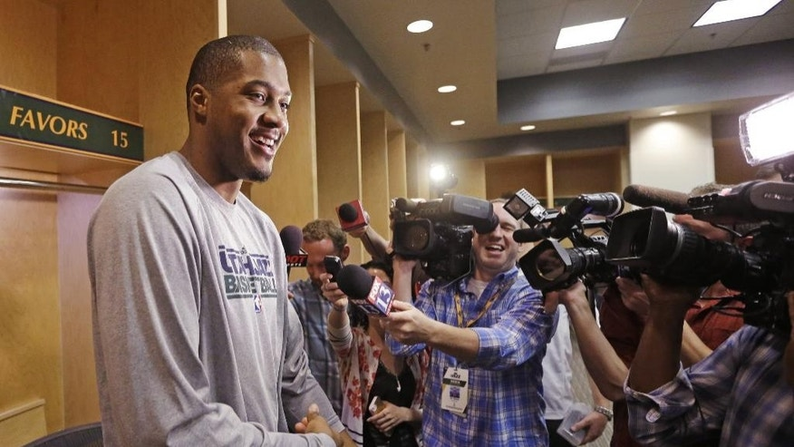 Utah Jazz's Derrick Favors speaks to reporters on the day the Jazz cleaned out their lockers after a 25-57 season, Thursday, April 17, 2014, in Salt Lake City. (AP Photo/Rick Bowmer)