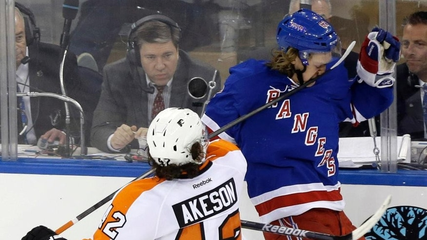 Philadelphia Flyers' Jason Akeson (42) hits New York Rangers' Carl Hagelin (62) in the face with his stick during the third period in Game 1 of an NHL hockey first-round playoff series on Thursday, April 17, 2014, in New York. Akeson was penalized on the play. The Rangers won the game 4-1. (AP Photo/Frank Franklin II)