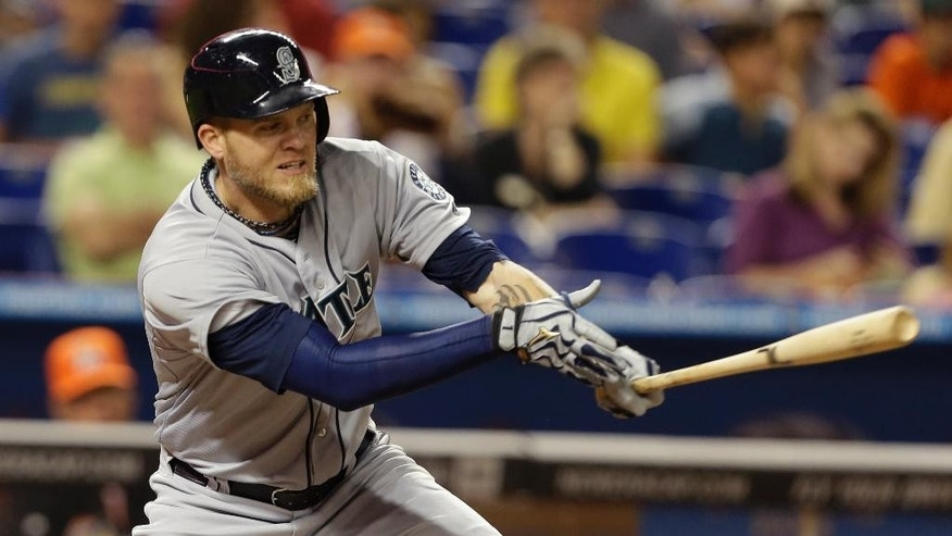 Seattle Mariners' Corey Hart hits a single during the fourth inning of an interleague baseball game against the Miami Marlins, Friday, April 18, 2014, in Miami. (AP Photo/Lynne Sladky)