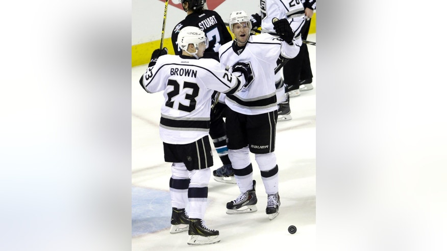 Los Angeles Kings' Trevor Lewis, right, is congratulated by Dustin Brown (23) after Lewis scored against the San Jose Sharks during the third period of Game 1 of an NHL hockey first-round playoff series Thursday, April 17, 2014, in San Jose, Calif. (AP Photo/Ben Margot)