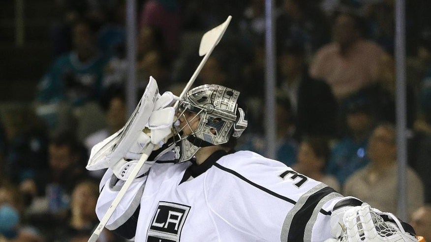 Los Angeles Kings goalie Jonathan Quick adjusts his mask during the second period of Game 1 of an NHL hockey first-round playoff series against the San Jose Sharks Thursday, April 17, 2014, in San Jose, Calif. (AP Photo/Ben Margot)