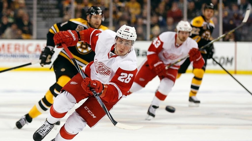 Detroit Red Wings' Tomas Jurco chases down a loose puck against the Boston Bruins during the first period of Game 1 of a first-round NHL playoff hockey series in Boston on Friday, April 18, 2014. (AP Photo/Winslow Townson)