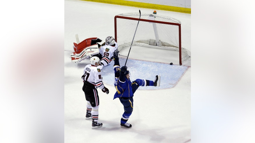 St. Louis Blues' Vladimir Tarasenko, of Russia, celebrates after scoring past Chicago Blackhawks goalie Corey Crawford (50) and Marian Hossa (81), of Slovakia, during the first period in Game 1 of a first-round NHL hockey Stanley Cup playoff series Thursday, April 17, 2014, in St. Louis. (AP Photo/Jeff Roberson)