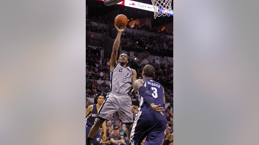 FILE - In this April 6, 2014 file photo, San Antonio Spurs' Kawhi Leonard (2) puts up at shot against Memphis Grizzlies'  James Johnson (3) during the second half of an NBA basketball game, in San Antonio. He has been called the future face of this franschise, and when Tim Duncan, Manu Ginobili and Tony Parker are done ruling the roost, he's ready to take over.  (AP Photo/Michael Thomas, File)