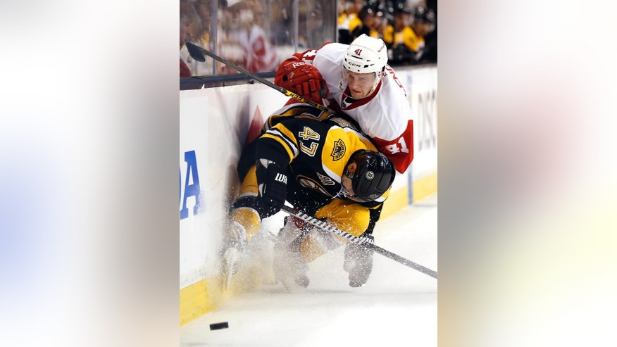 Boston Bruins defenseman Torey Krug (47) stops Detroit Red Wings' Luke Glendening (41) from getting around him during the first period of Game 2 of a first-round NHL hockey playoff series in Boston, Sunday, April 20, 2014. (AP Photo/Winslow Townson)