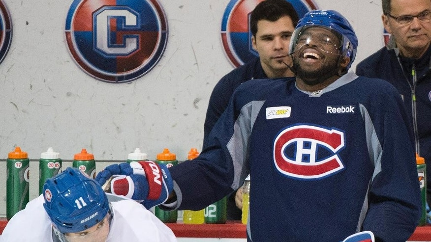 Montreal Canadiens' P.K. Subban, right, laughs alongside teammate Brendan Gallagher during a practice session in Brossard, Quebec,  Monday, April 21, 2014. The Canadiens lead Tampa Bay 3-0 in their best-of-seven series in the first round of the playoffs. (AP Photo/The Canadian Press, Graham Hughes)
