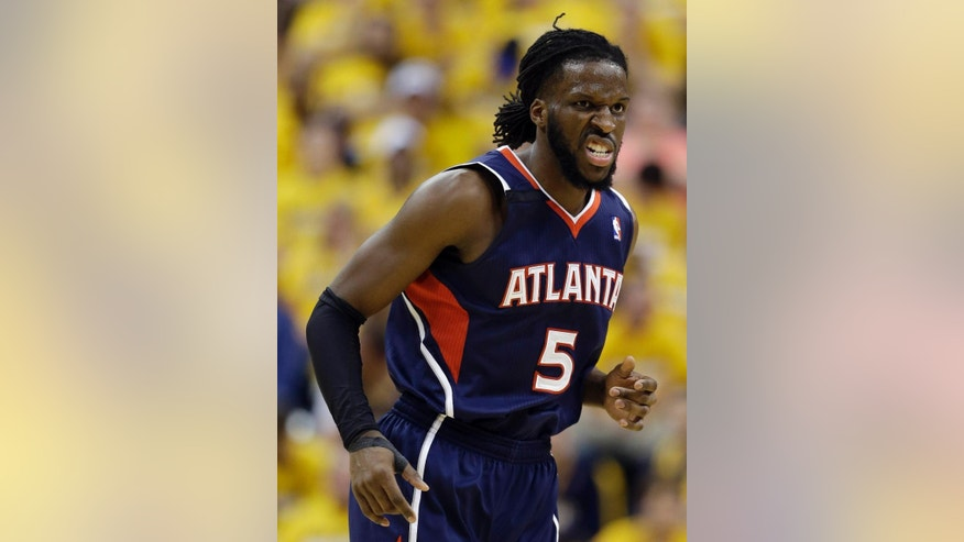 Atlanta Hawks' DeMarre Carroll reacts after hitting a basket during the second half in Game 1 of an opening-round NBA basketball playoff series against the Indiana Pacers, Saturday, April 19, 2014, in Indianapolis. Atlanta defeated Indiana 101-93. (AP Photo/Darron Cummings)